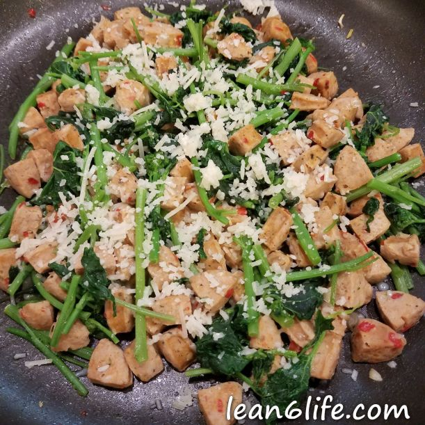 Garlic mustard with chicken sausage and Parmesan cheese