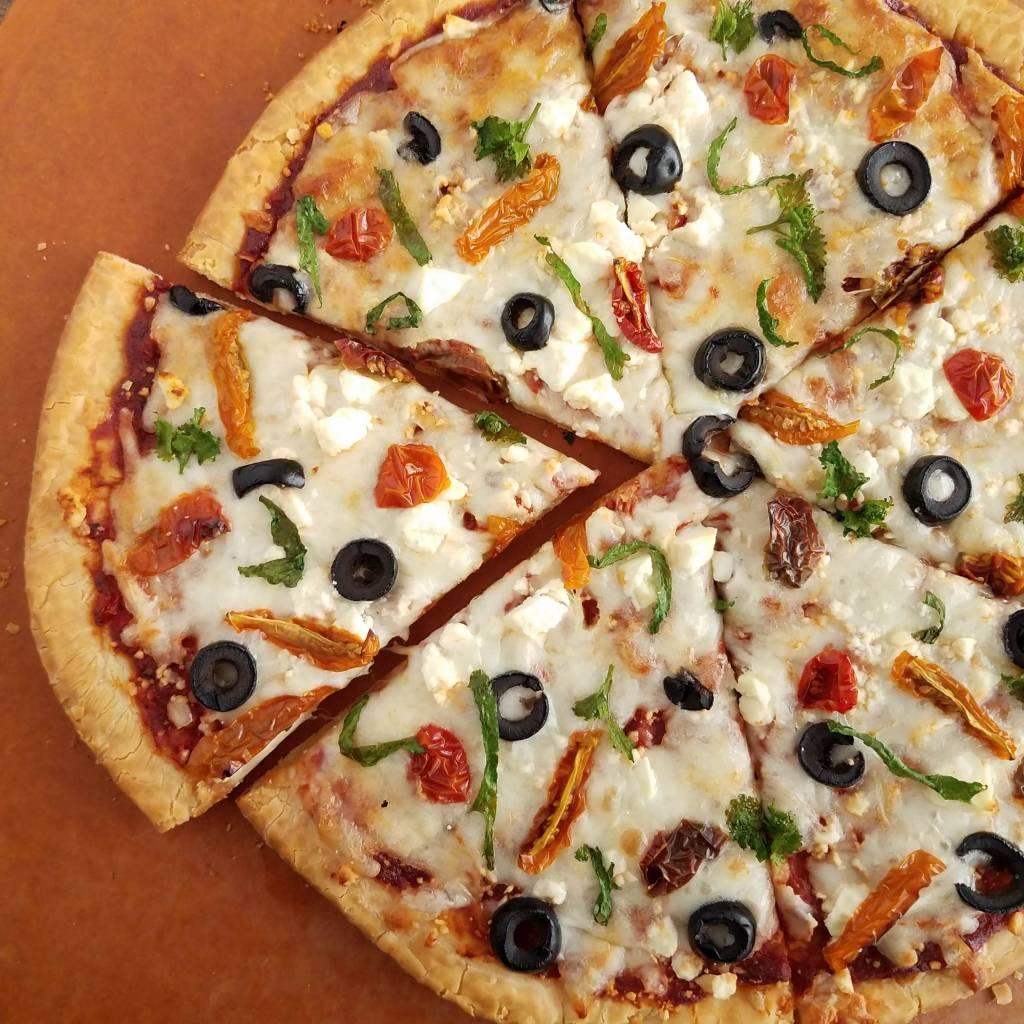 Garlic mustard garnish kicks up the flavor on pizza