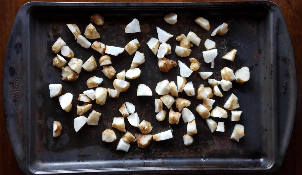 Chopped sunchokes ready to roast