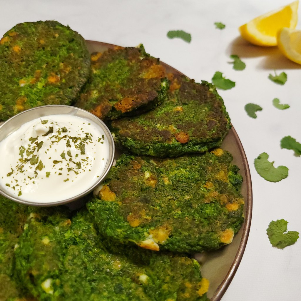 Spring green fritters with a simple sour cream dip and lemon wedges